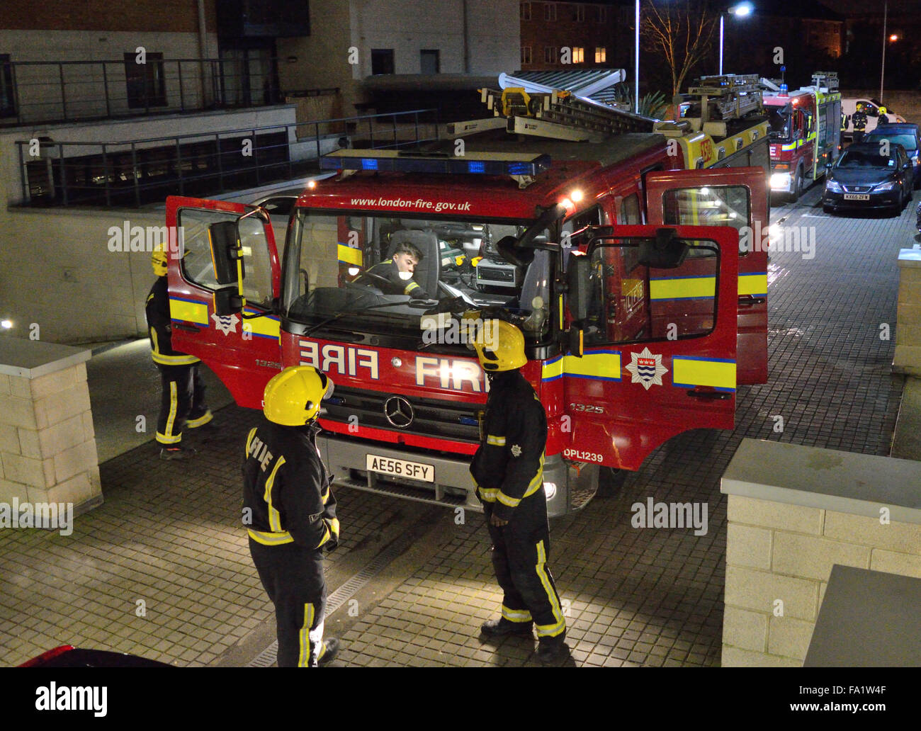Two appliances from London Fire Brigade attend a flat fire in North Woolwich, London - Stock Image