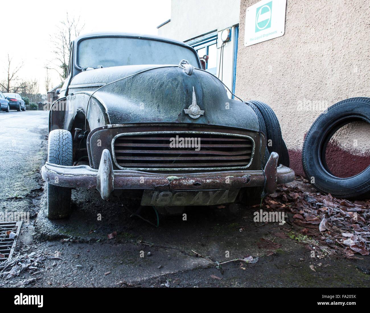 Old Morris Minor Car rusting away - Stock Image