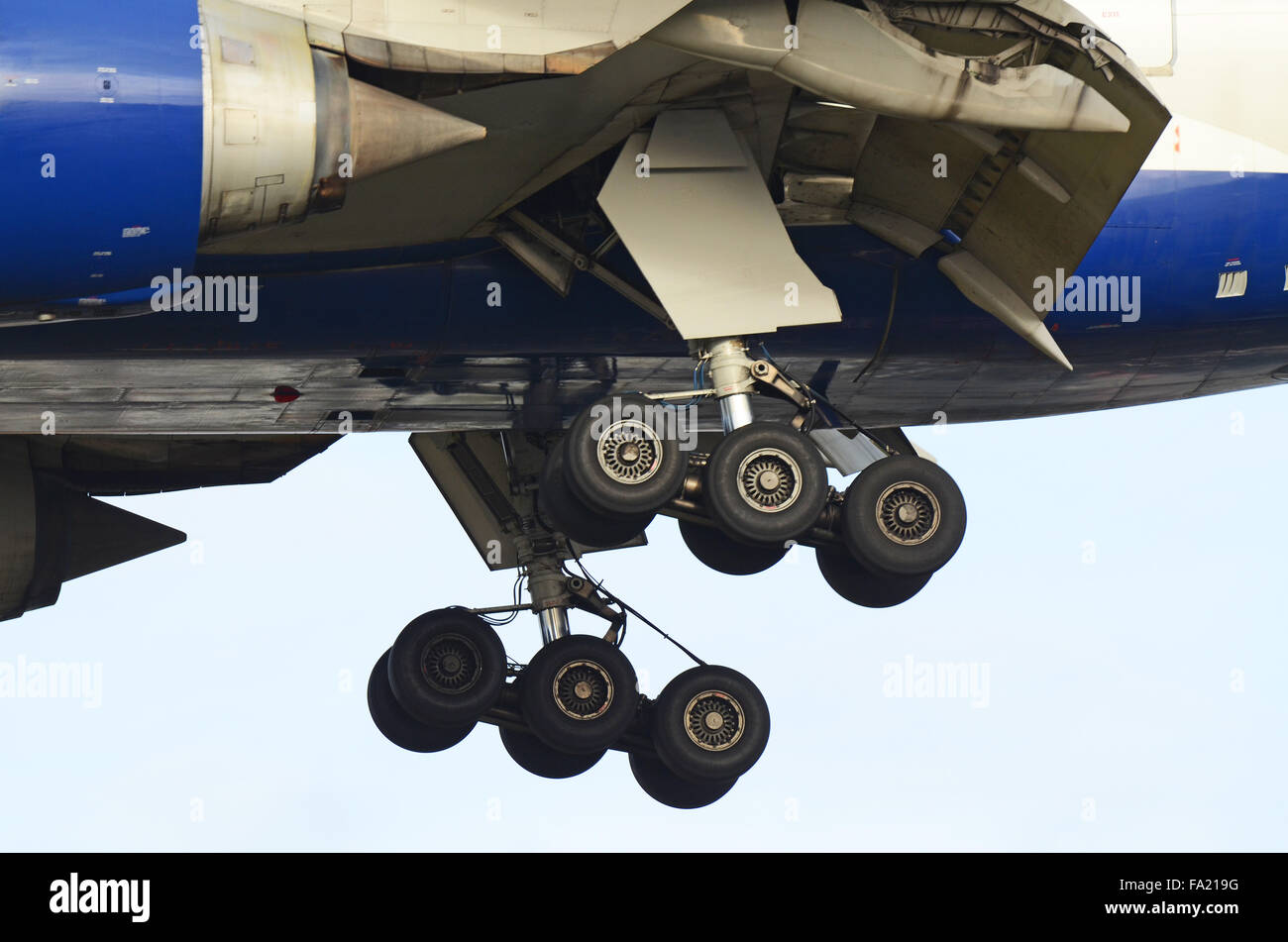 Undercarriage of a British Airways Boeing 777 plane as it comes in to land at London Heathrow Airport. Space for - Stock Image