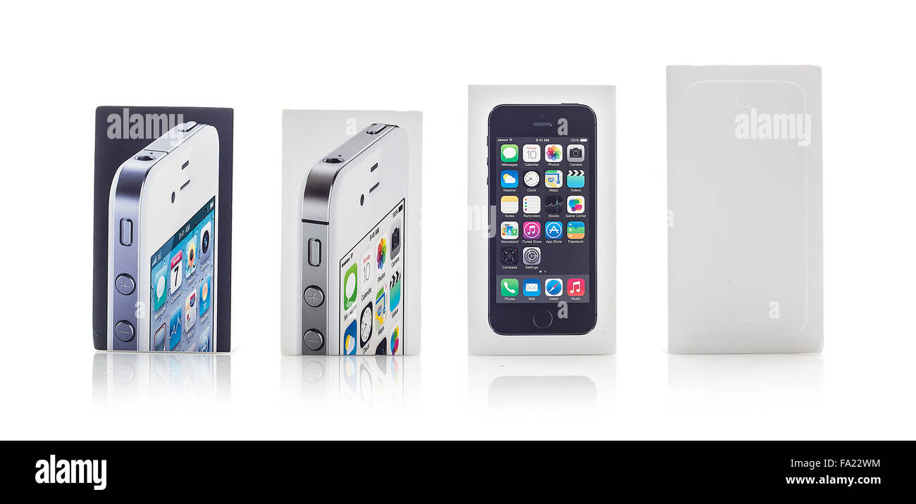 Collection of used Apple iPhone boxes on a white background showing
