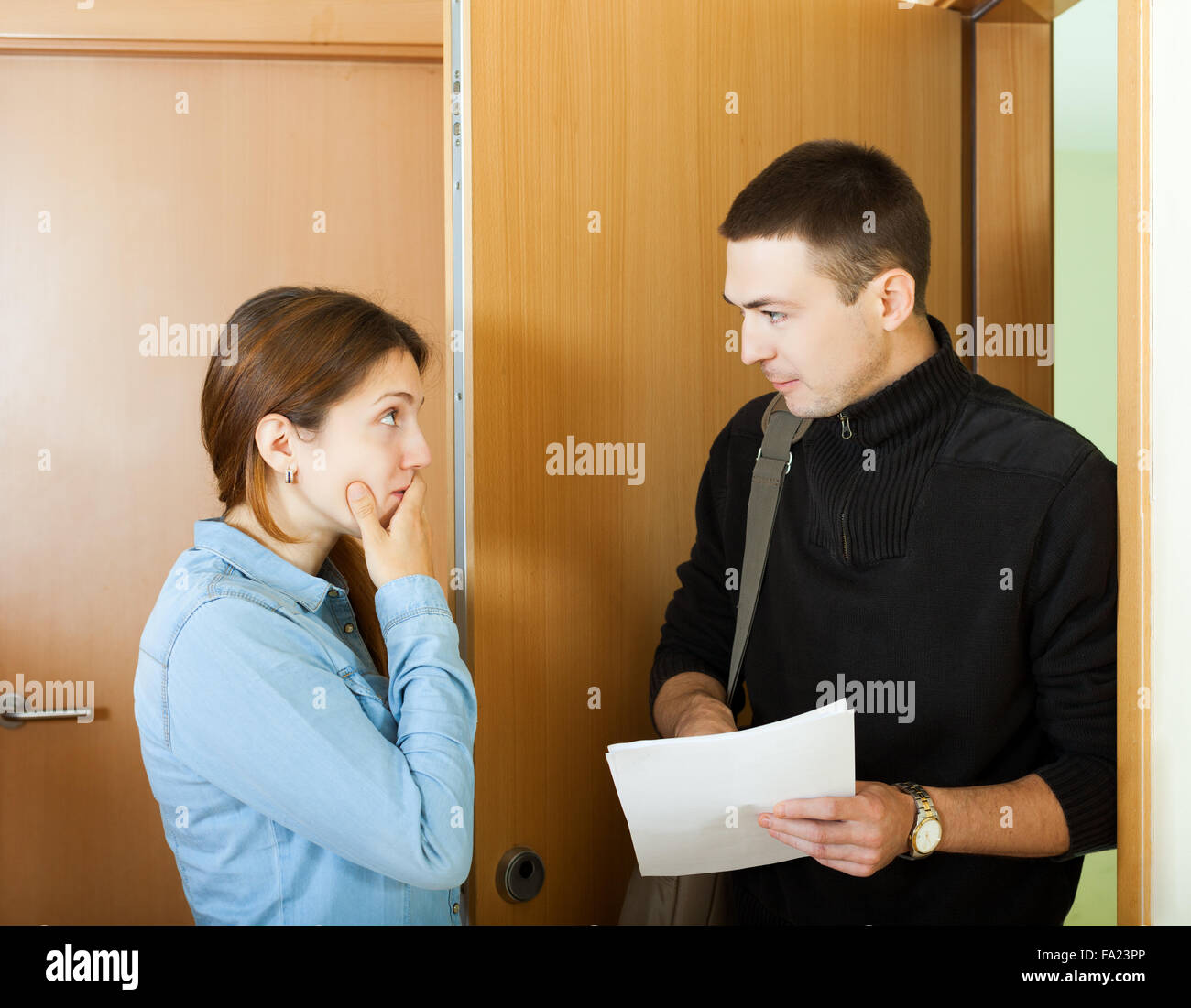 collector is trying to get the arrears from woman - Stock Image
