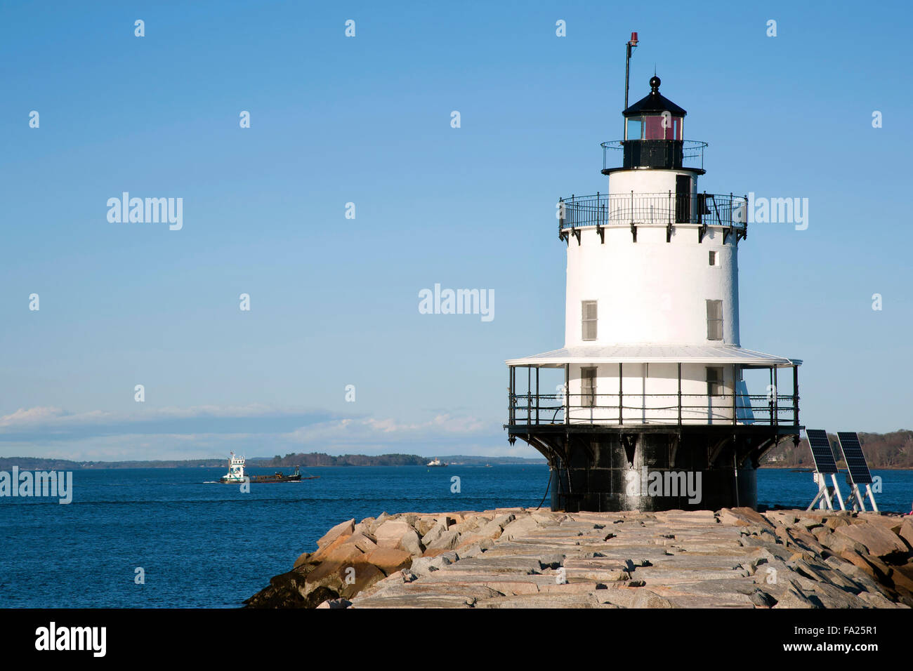 Spring Point Lighthouse guiding boat into Portland Harbor in Maine on a summer day. The design beacon of the beacon - Stock Image