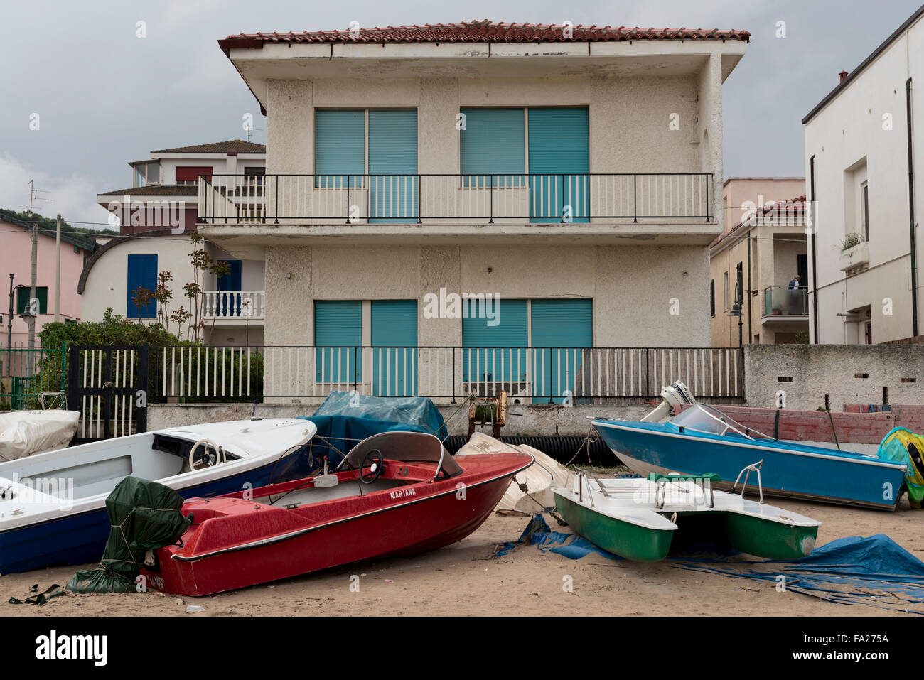 Beached boats on the seaside - Stock Image