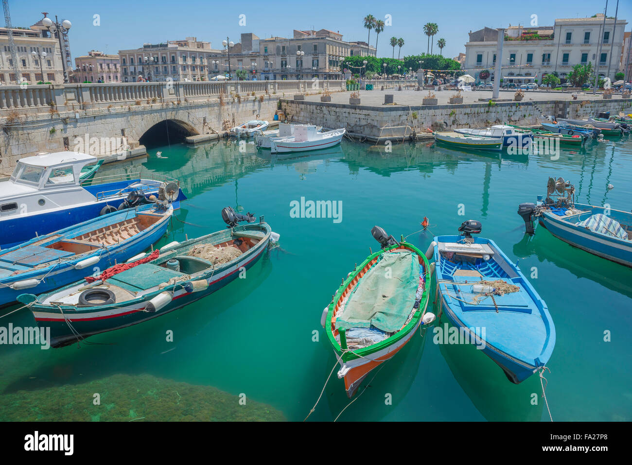Fishing boats sicily, view of fishing boats moored in the inner harbour at Syracuse, Siracusa, Sicily. - Stock Image