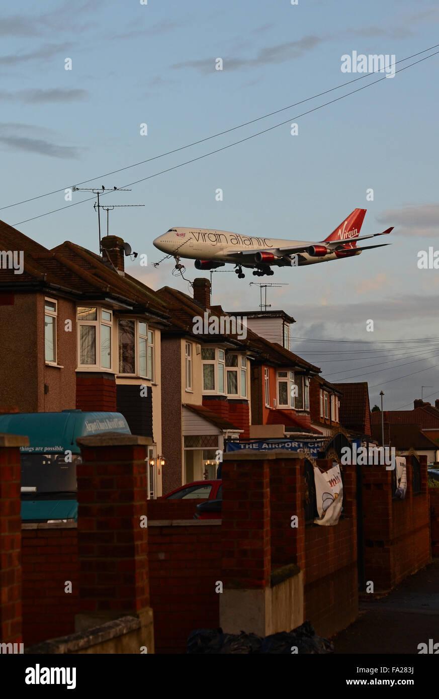 Virgin Atlantic Boeing 747 Jumbo Jet airliner plane landing at London Heathrow Airport, UK low over local housing Stock Photo