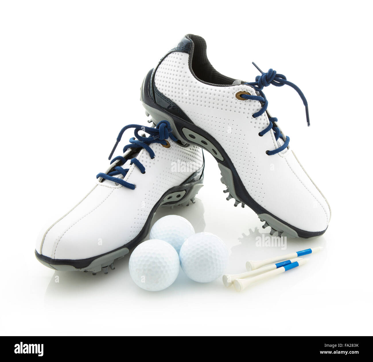 Modern Golf Shoes With Balls and Tees on a White Background - Stock Image