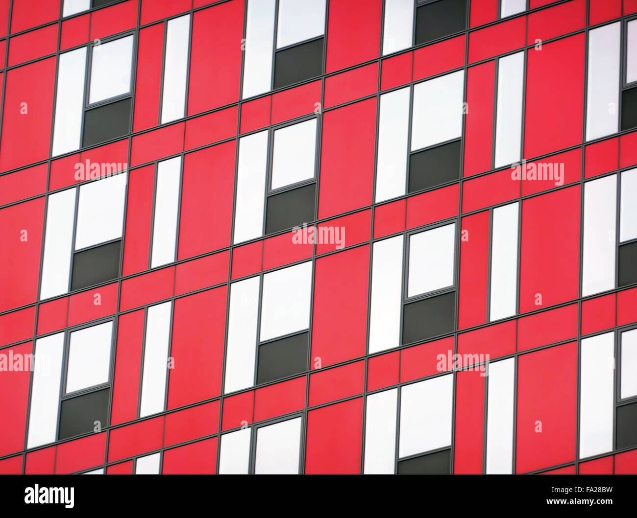 Modern facade with black and red glass panels - Stock Image