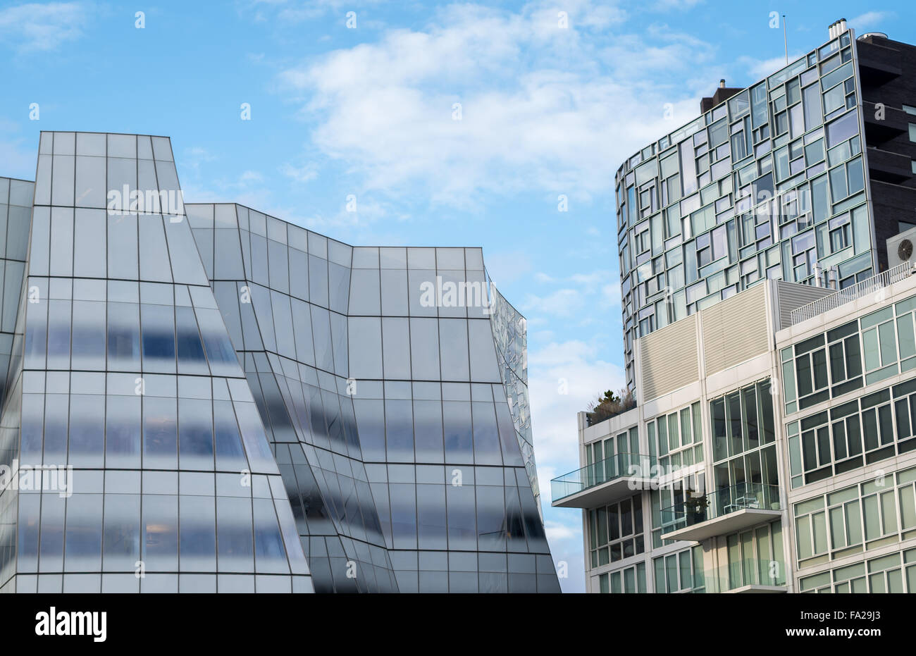 The IAC HQ, Chelsea Nouvel, Metal Shutter Houses and 520 West Chelsea on a bright sunny day in NYC. - Stock Image