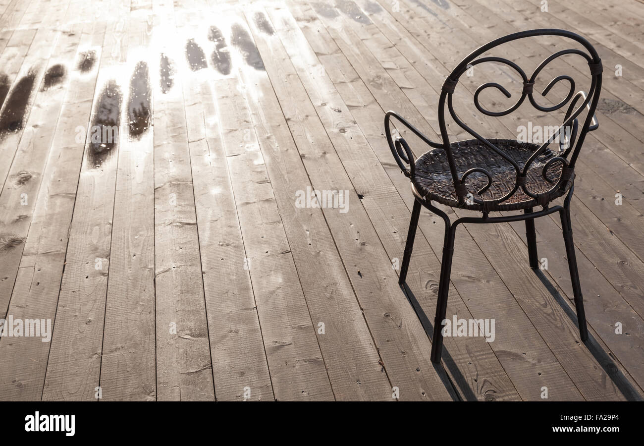 Old Black Wrought Iron Chair Standing On Wooden Floor, Outdoor Photo    Stock Image