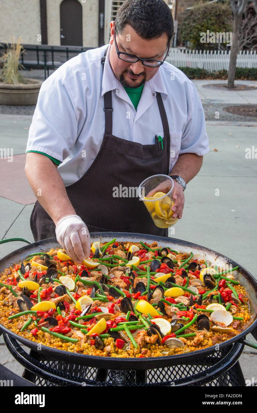 Basque Market, Chief Cook Jake Arrepondo preparing' Paella' Spains Most Famous Meal on Iconic Pan for Lunch, - Stock Image