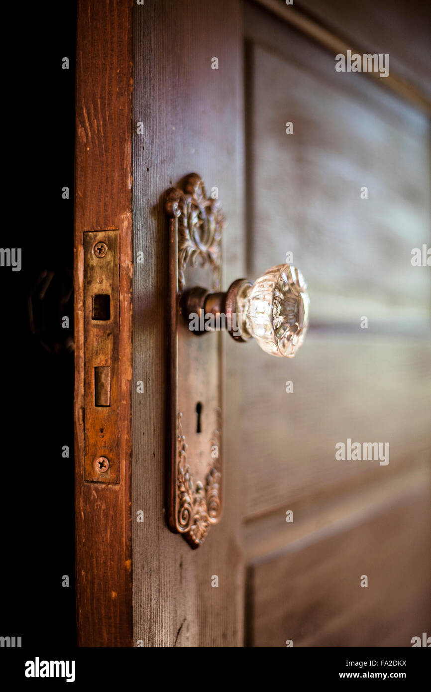 An old door, open with an ornate door knob Stock Photo: 92253054 - Alamy
