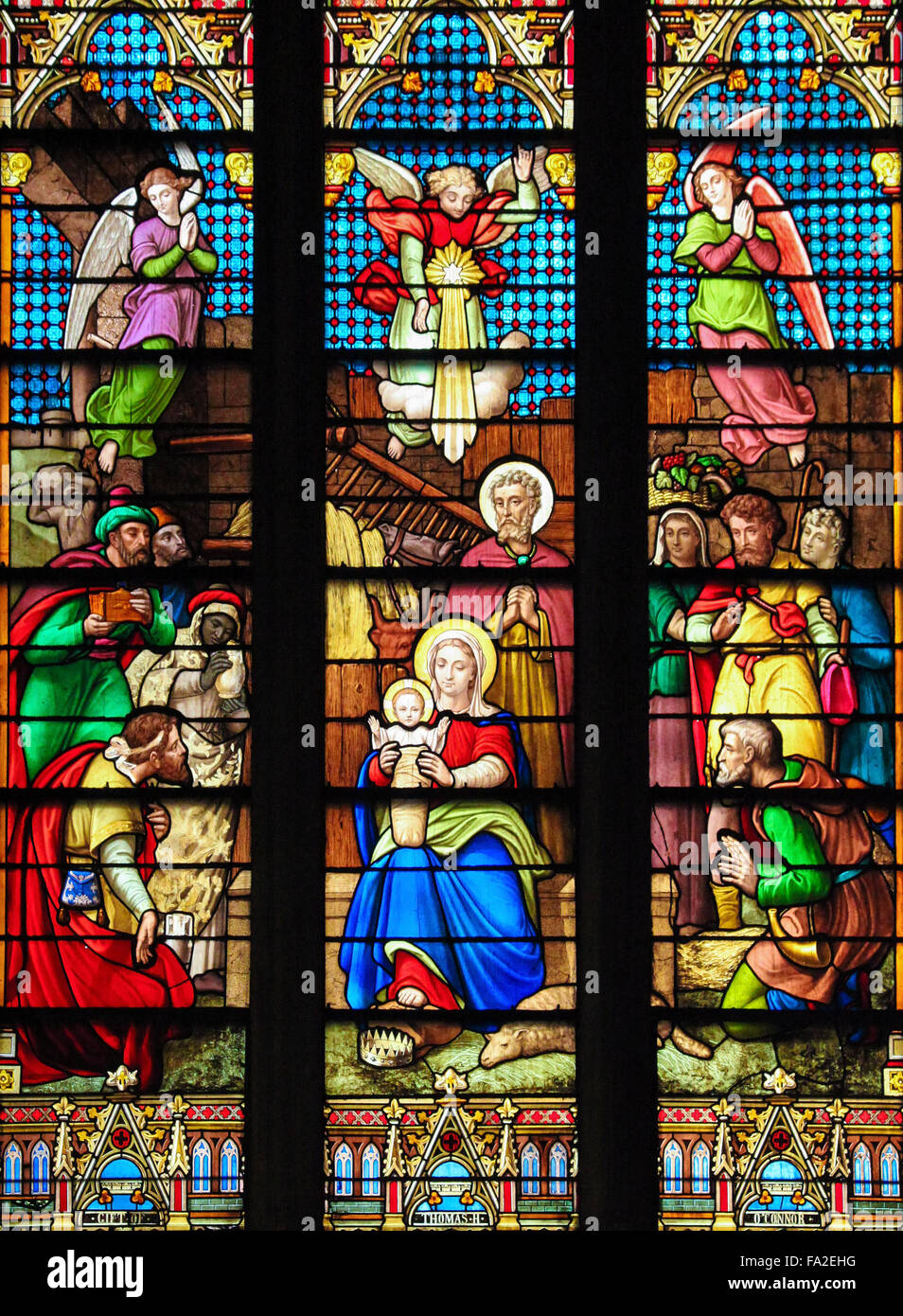 NEW YORK, US - SEPTEMBER 14, 2012: Stained Glass window depicting a Nativity Scene at Christmas in St. Patrick's - Stock Image