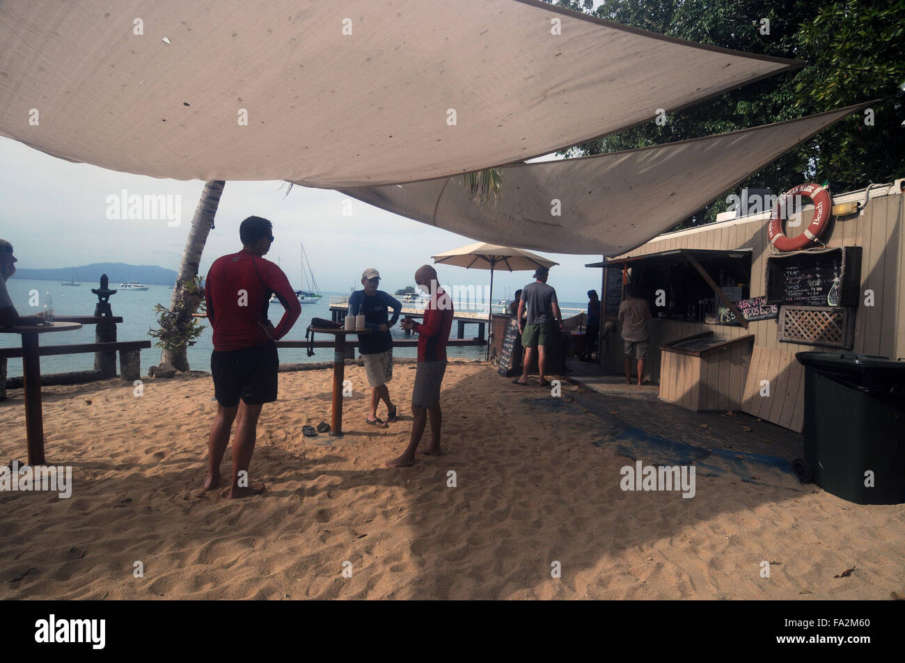 People having a drink at the new Dunk Island Cafe, Family Islands National Park, near Mission Beach, Queensland, - Stock Image