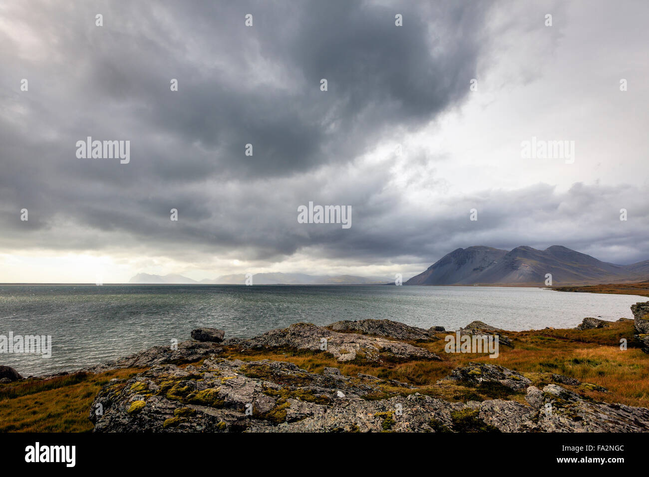 Scenic view of southern coast of Iceland and Northern Atlantic with overcast skies - Stock Image