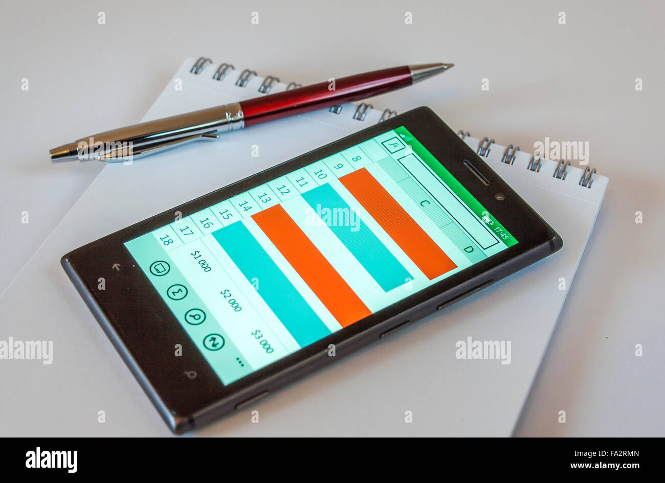 Pen,Smart Phone On Notepad - Stock Image