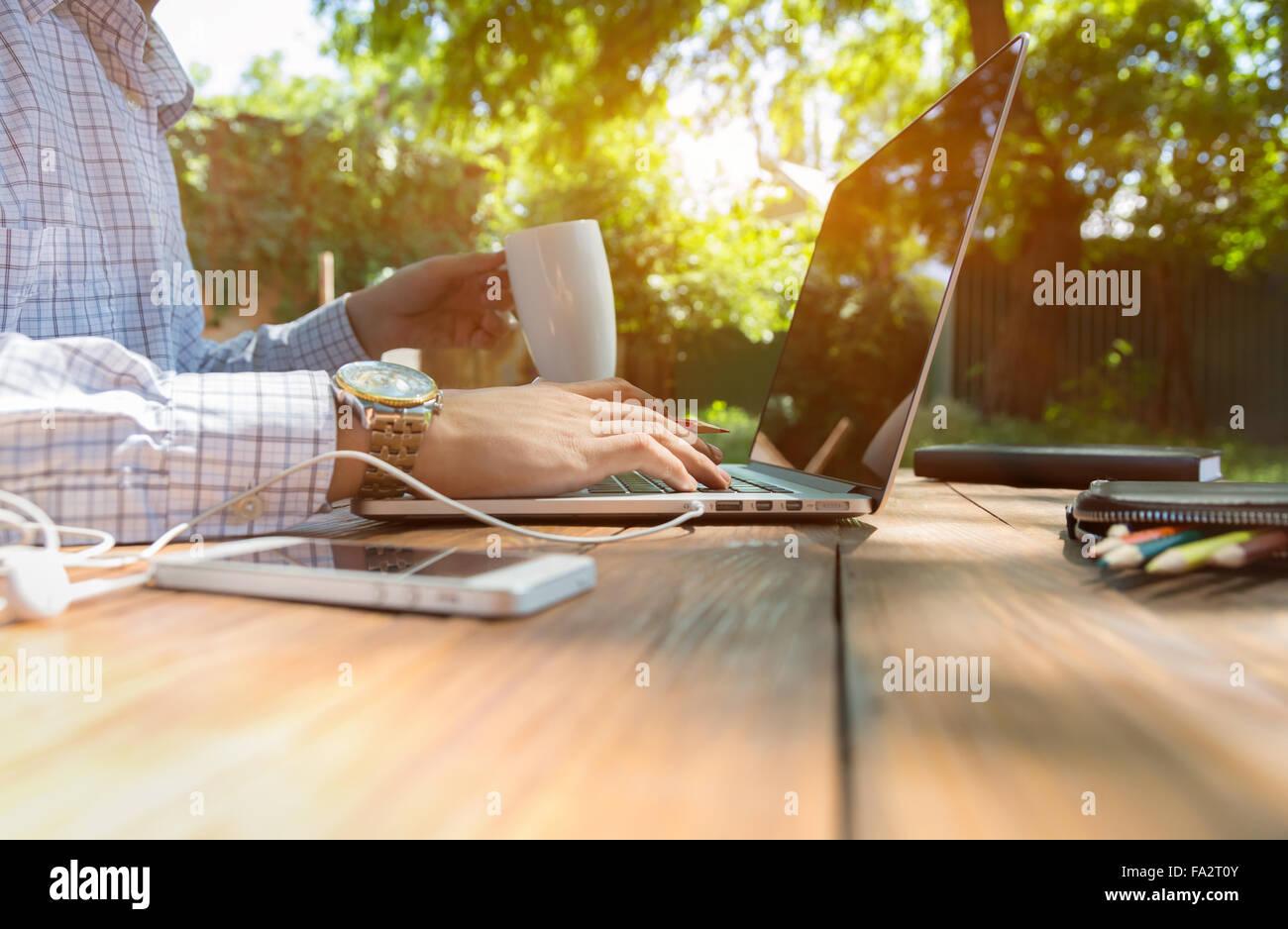 Businessman working outdoor - Stock Image