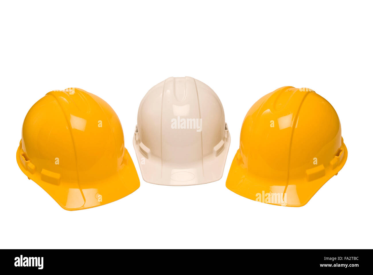 Three Construction Helmets Isolated on White - Stock Image