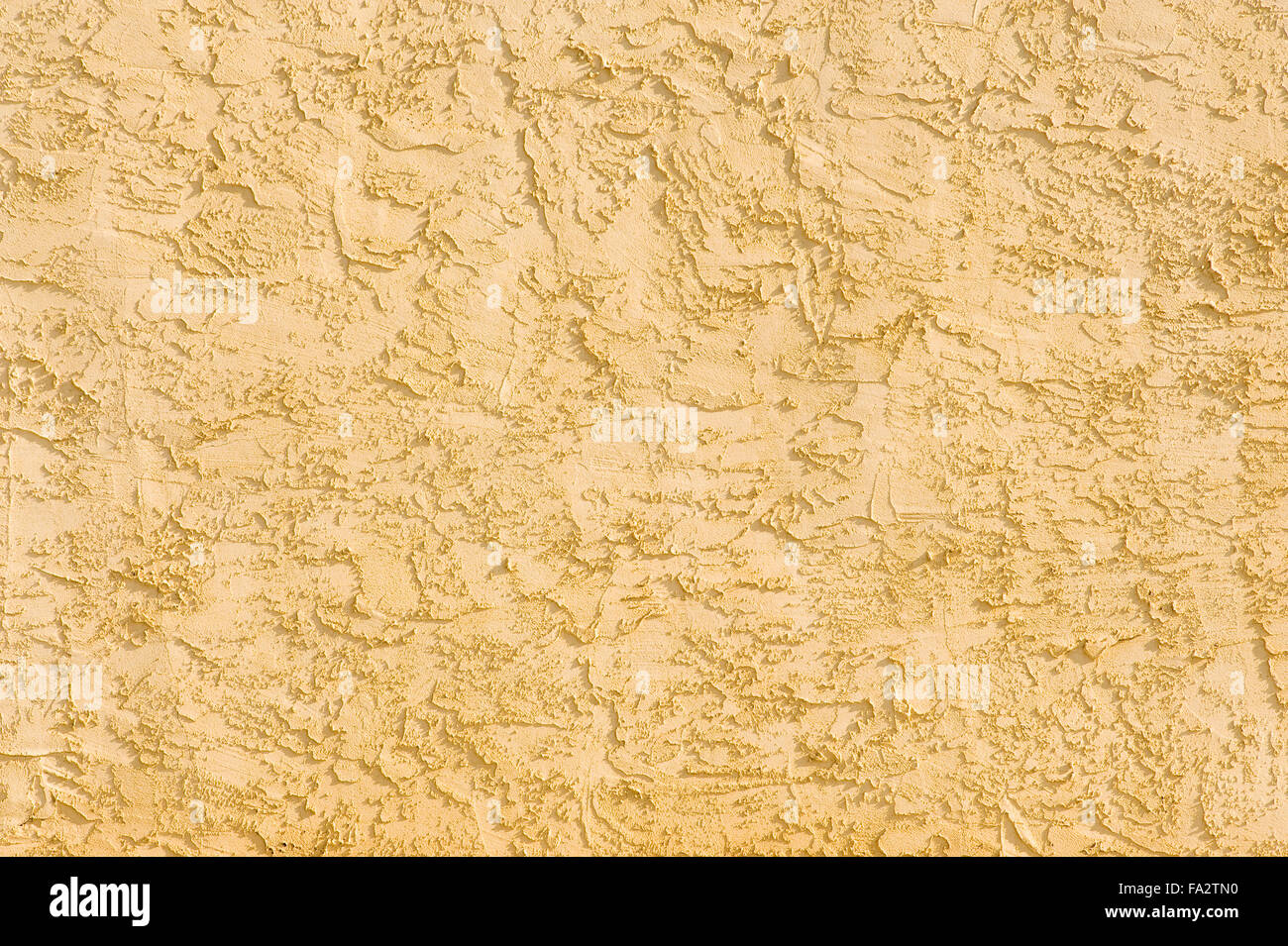 Warm-tone Stucco Wall Background - Stock Image