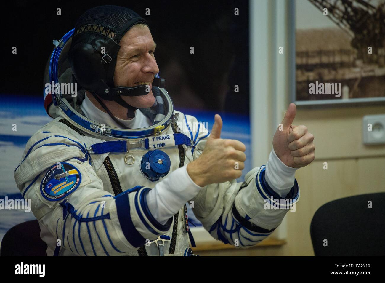 International Space Station Expedition 46 crew member British astronaut gives the thumbs up as he waits to have - Stock Image