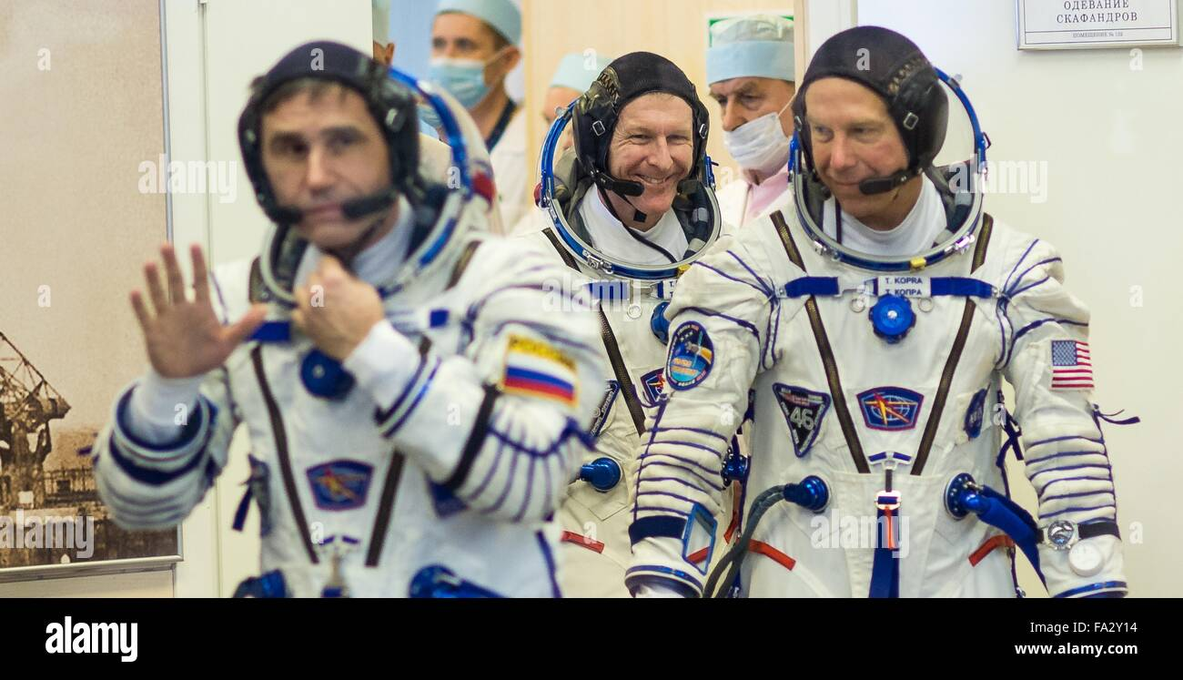 International Space Station Expedition 46 crew members in their Russian Sokol space suits as they complete preparations - Stock Image