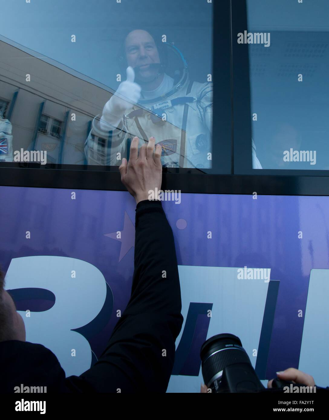 International Space Station Expedition 46 crew member American Tim Kopra gives the thumbs up from a bus as he depart - Stock Image