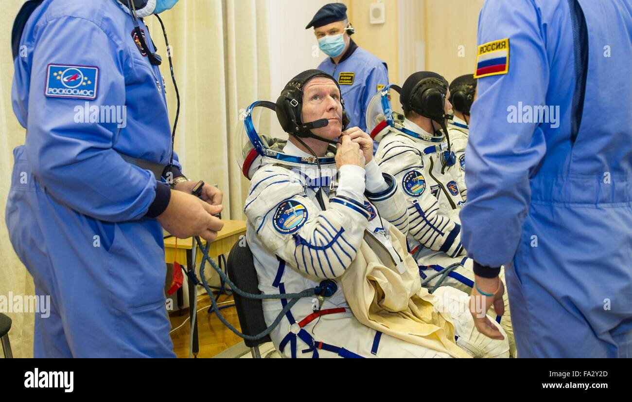 International Space Station Expedition 46 crew members have their Russian Sokol space suits adjusted in Building - Stock Image