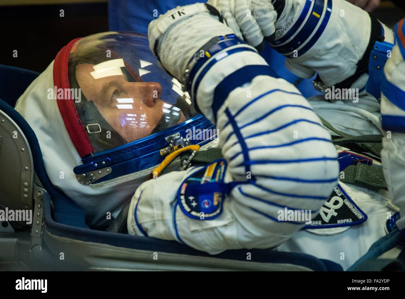 International Space Station Expedition 46 crew member American astronaut Tim Kopra has his Sokol space suits adjusted - Stock Image