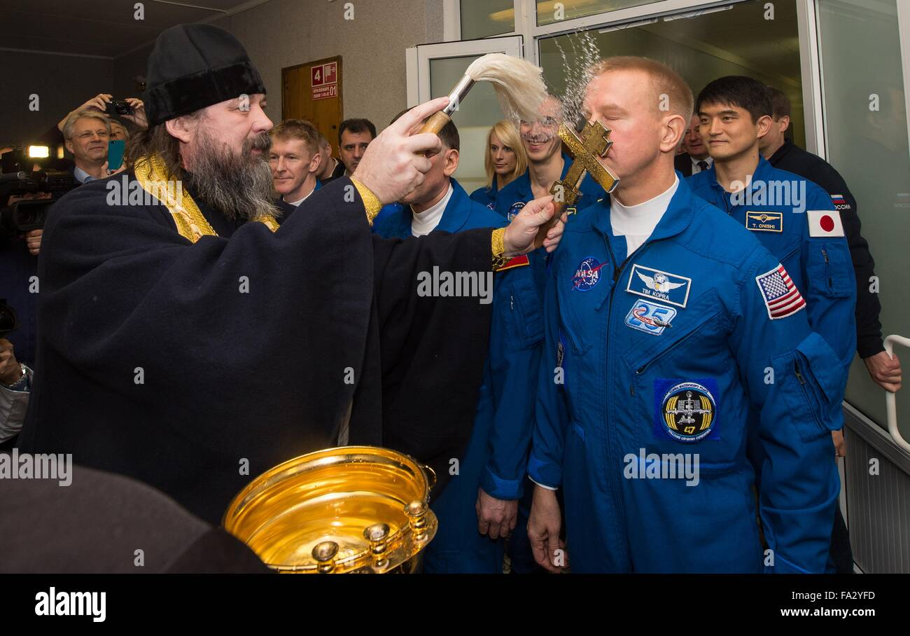 A Russian Orthodox priest blesses Expedition 46 Flight Engineer Tim Kopra of NASA at the Cosmonaut Hotel prior to - Stock Image