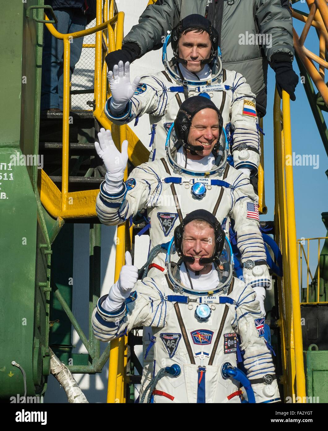 International Space Station Expedition 46 crew members in their Russian Sokol space suits wave as they board the - Stock Image