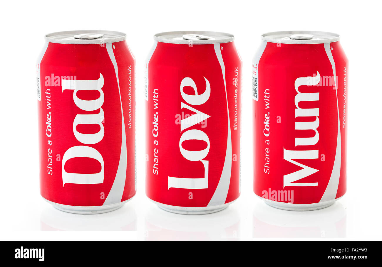 Three Cans of Coca-Cola, share a Coke With Mum, Dad, Love on a white background produced for the 2014 Share a Coke - Stock Image
