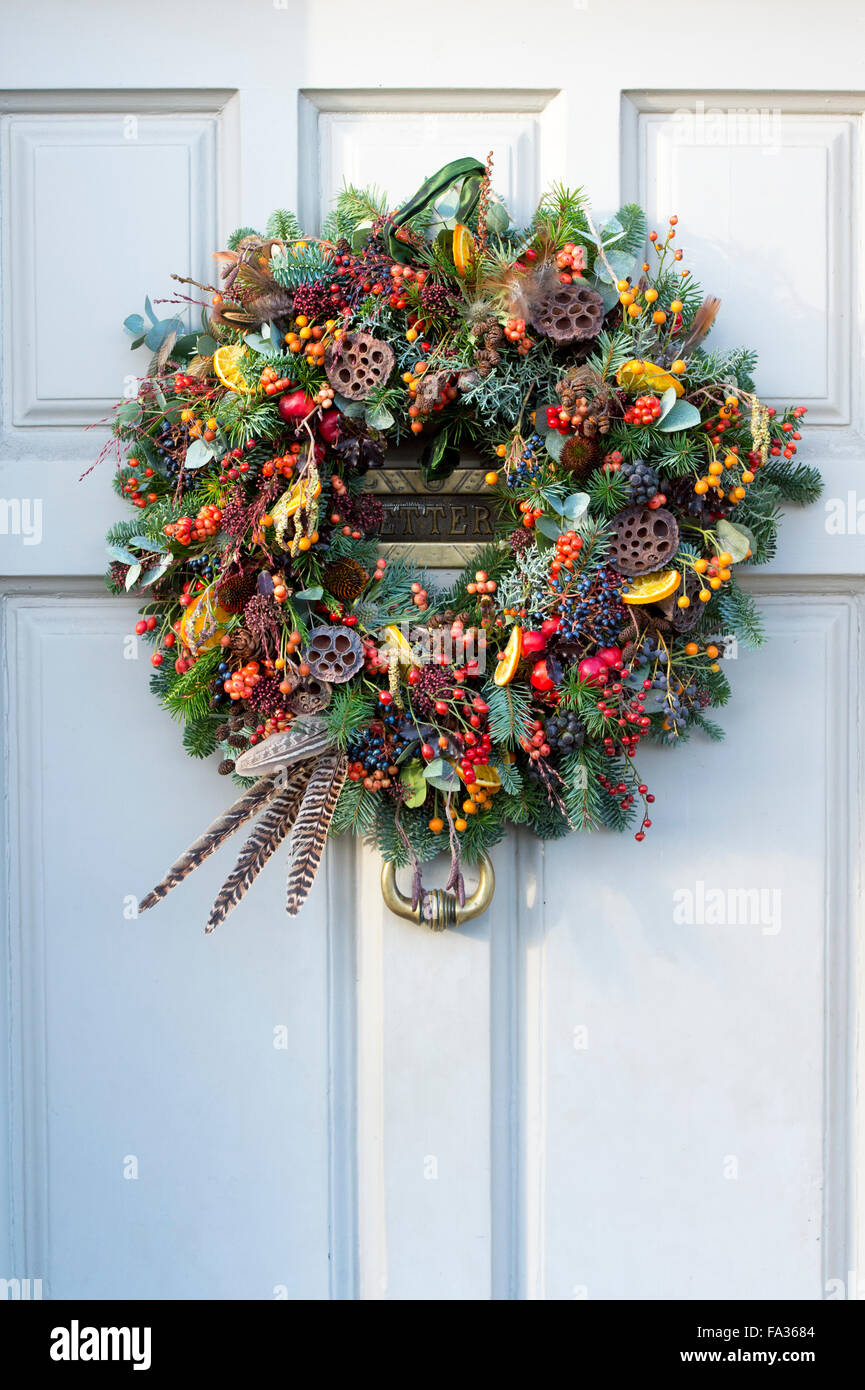 photo uk and stock photos cotswolds feather england wreaths wreath wooden doors christmas foliage berry fruit door on