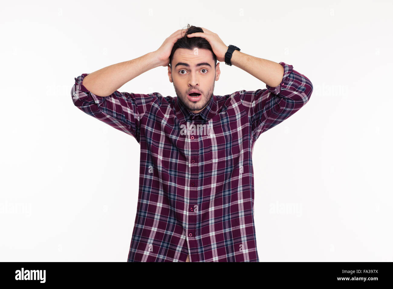 Portrait of a scared man looking at camera isolated on a white background - Stock Image