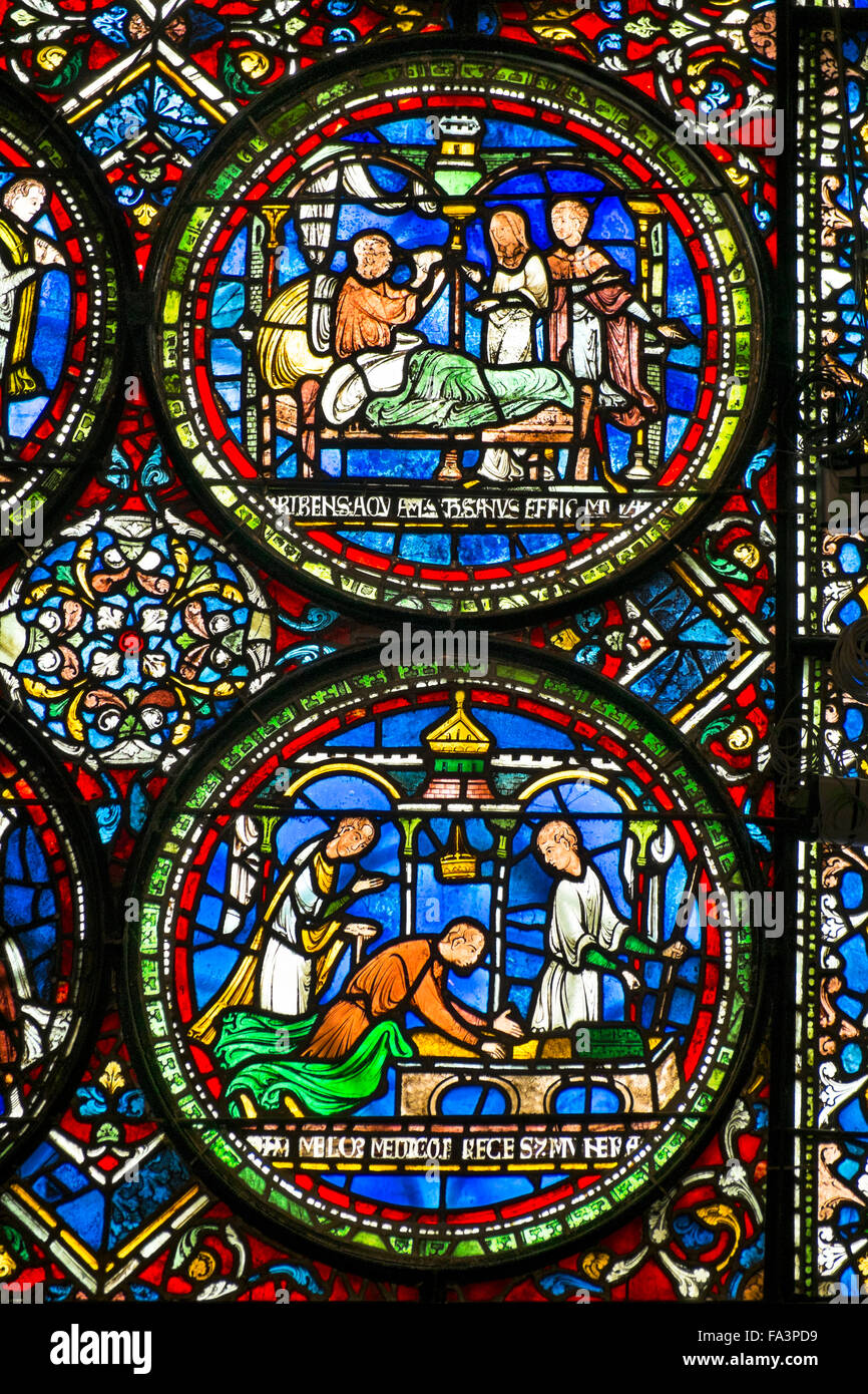 Medieval stained glass in Canterbury cathedral - Stock Image