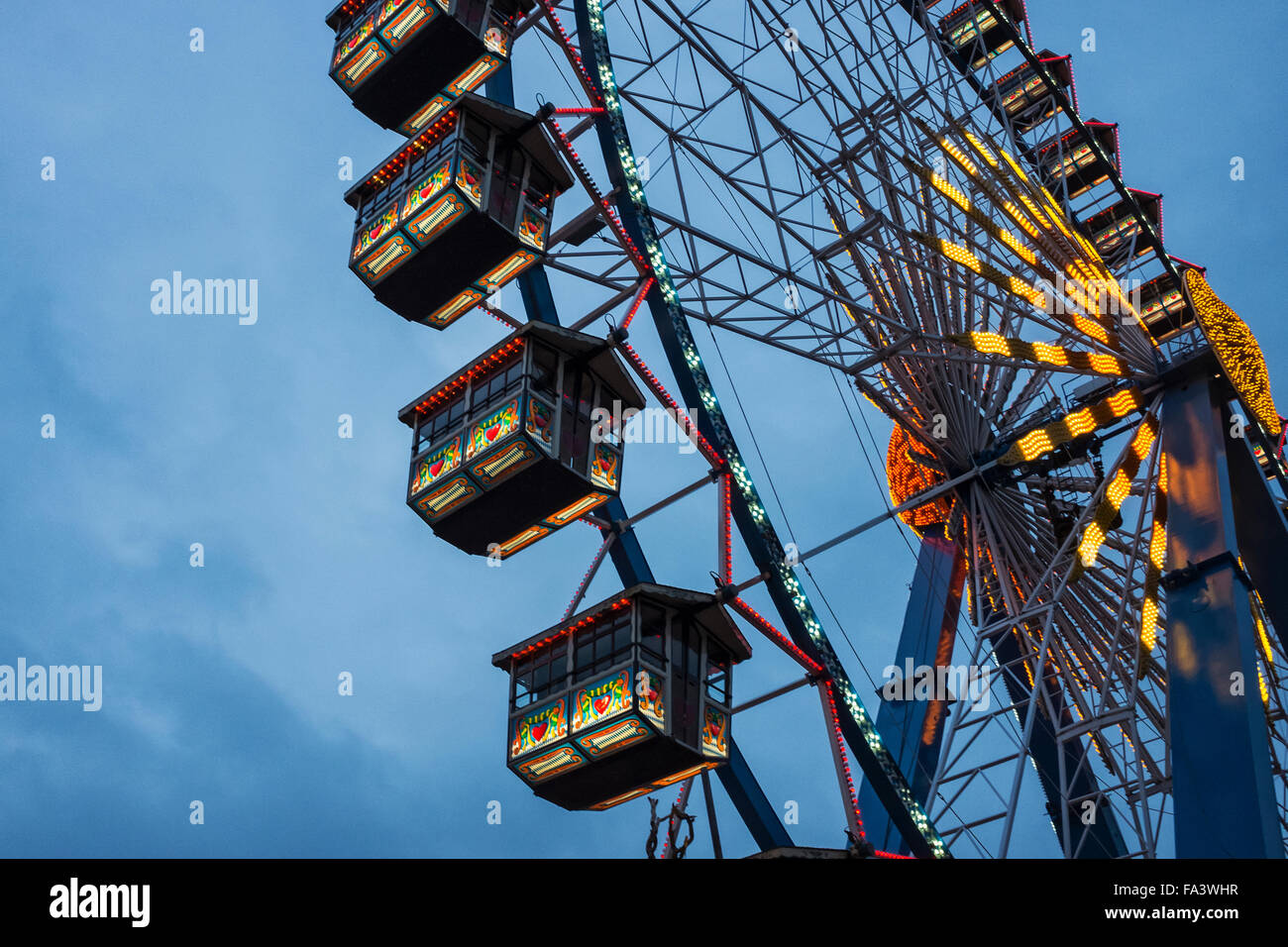 Berlin, Old ferris wheel with painted pods at Weihnachtszeit German Christmas market - Stock Image
