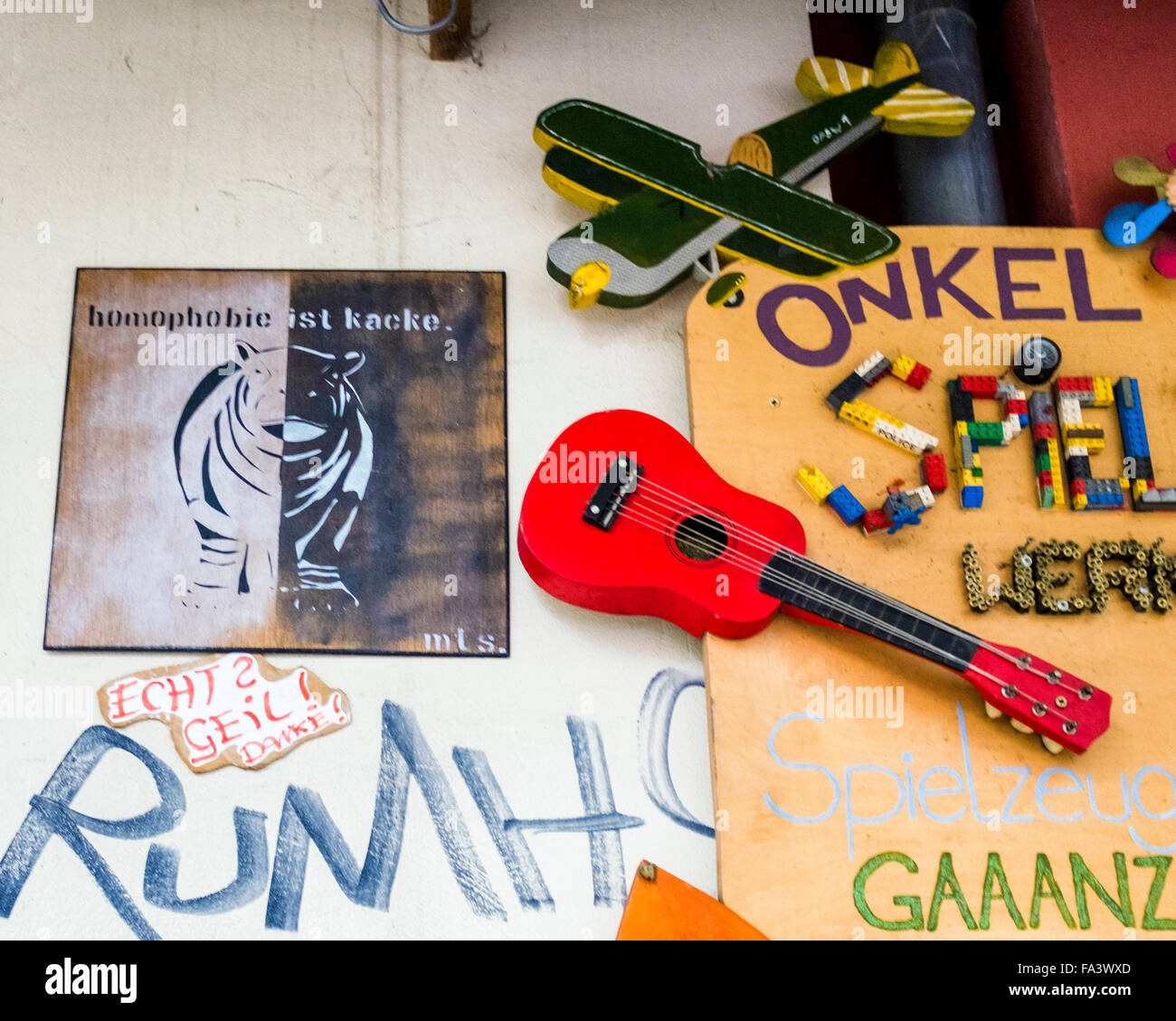 'Homophobic ist kacke' poster and toy display outside Berlin shop - Stock Image