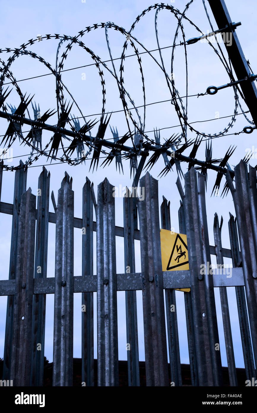 Permanent spiked steel barrier fencing, razor wire and electrified ...