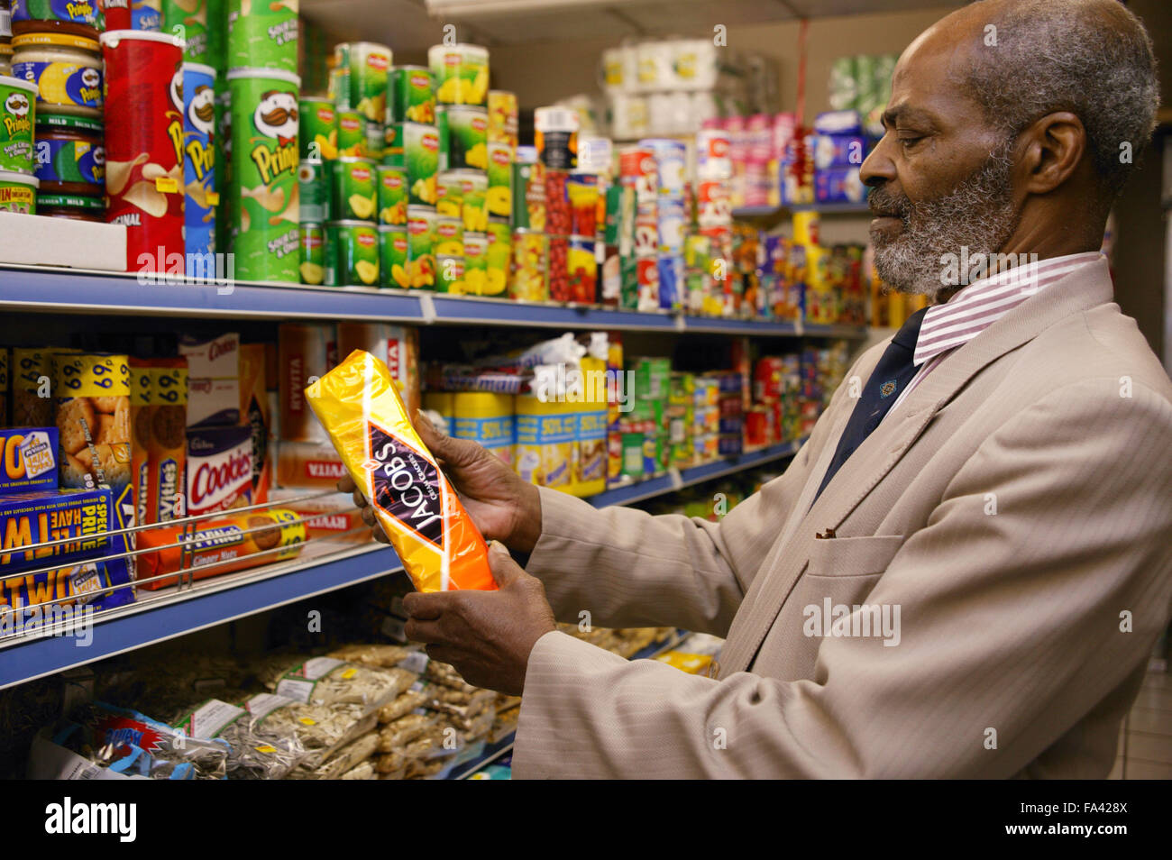 Man at his local shop; East Midlands Supermarket; Nottingham, - Stock Image