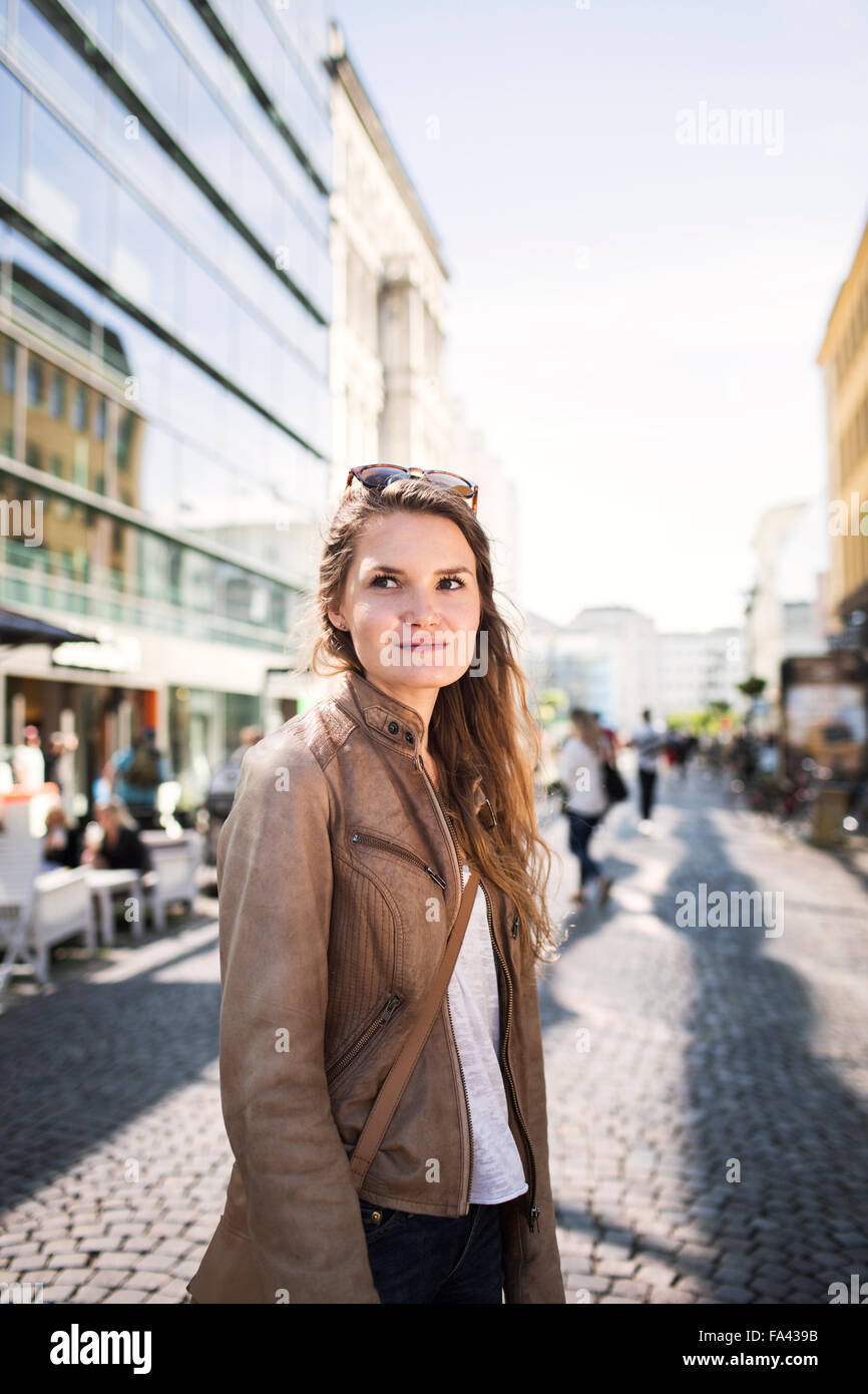 Beautiful young woman on city street - Stock Image
