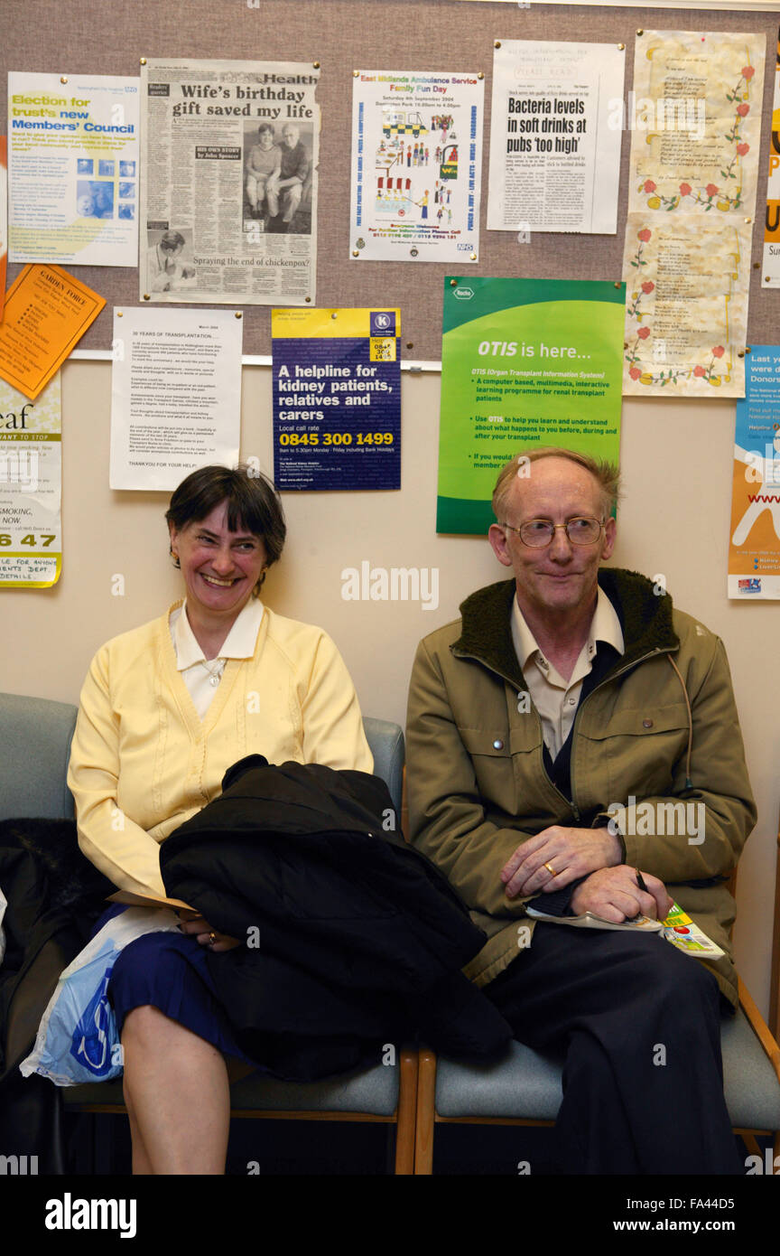 Couple at the waiting area of the Outpatients clinic, - Stock Image