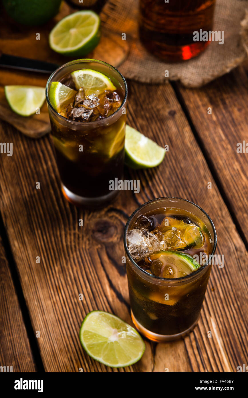 Fresh made Cuba Libre with brown rum and tasty lime - Stock Image