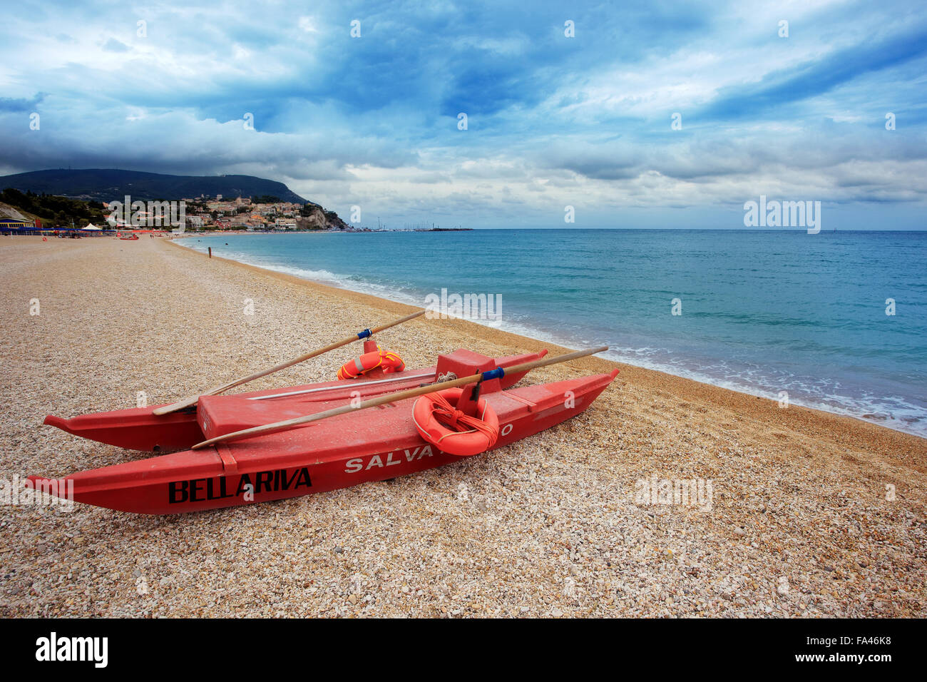 A beach with a watercraft - Stock Image