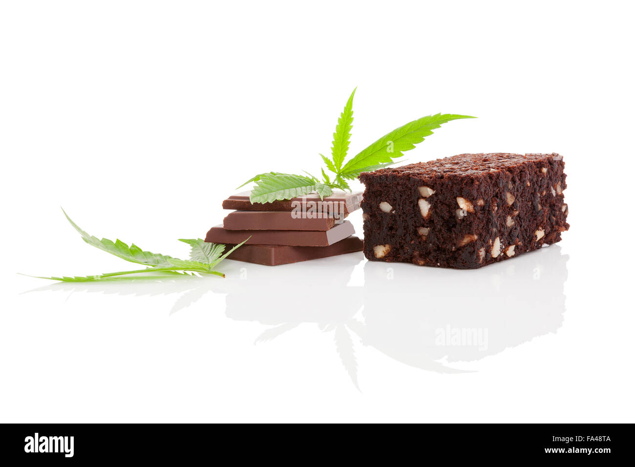 Cannabis chocolate and cannabis brownie with ganja leaf isolated on white background. - Stock Image
