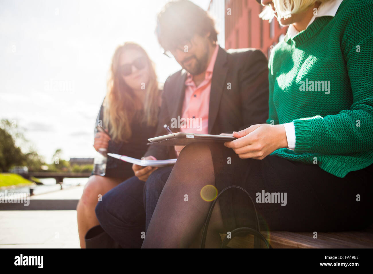 Business people discussing over digital tablet at Malmo Live - Stock Image