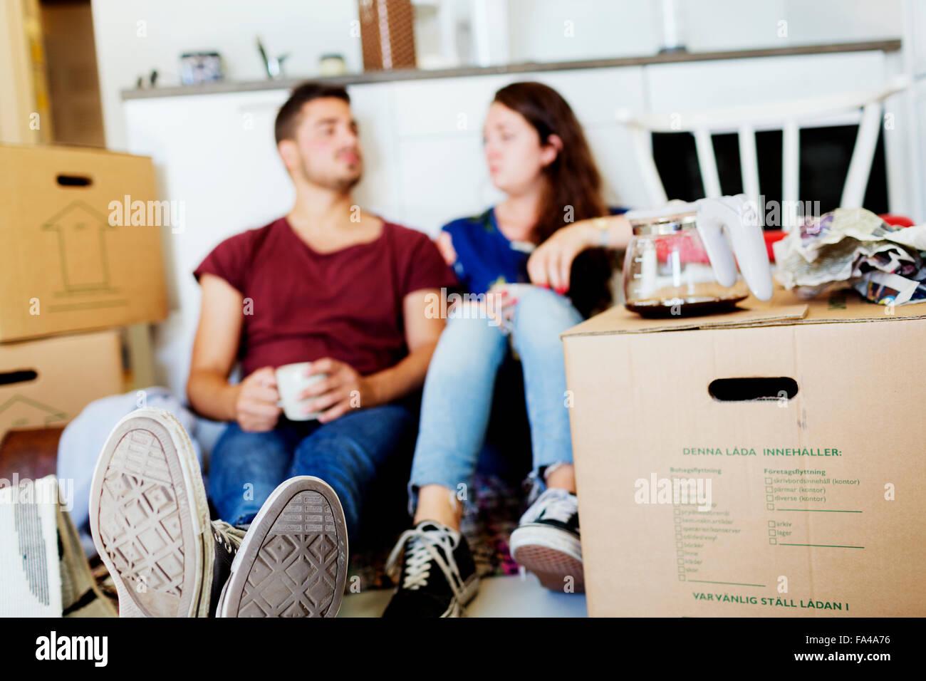 Take Break Coffeebreak : Young couple taking coffee break in new house stock photo