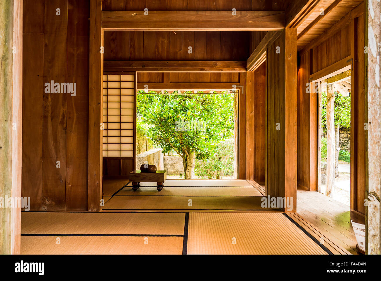 Traditional Okinawan home at open air museum near Okinawa Churaumi Aquarium, Japan - Stock Image