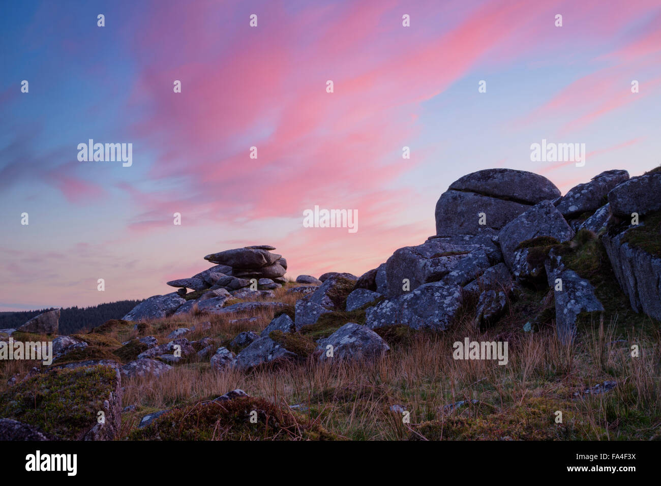 Sunset over the rocky outcrop of Trewortha Tor on Bodmin Moor - Stock Image