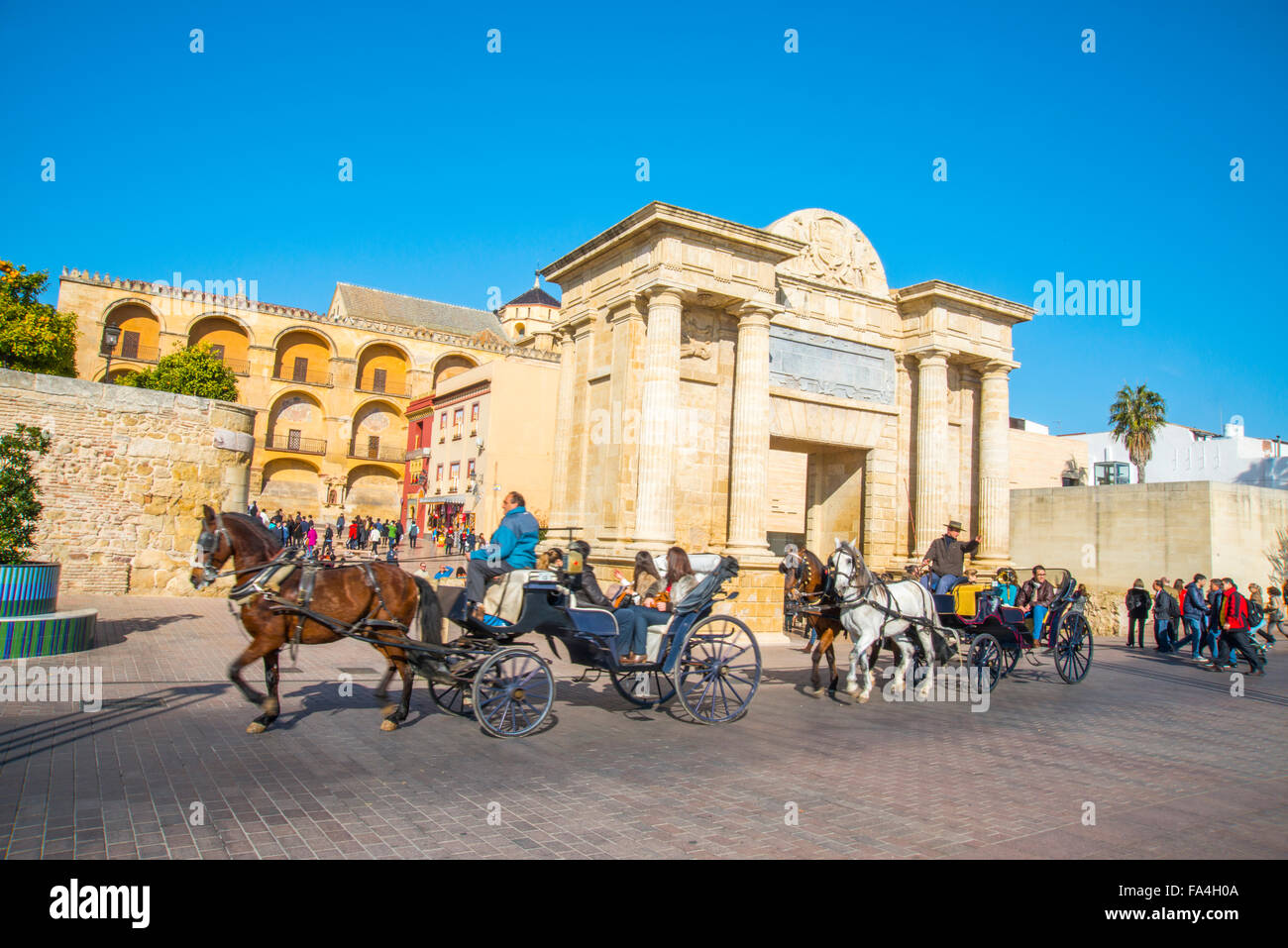 Horse-drawn carriages by the Bridge Gate. Cordoba, Spain. - Stock Image