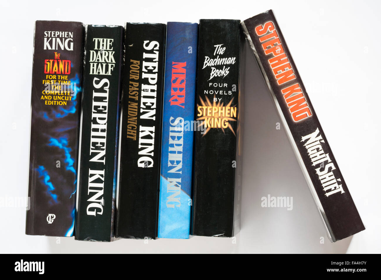 row of Stephen King books including Four Past Midnight, The Dark Half, the Stand, Night Shift, Misery and Four Novels - Stock Image