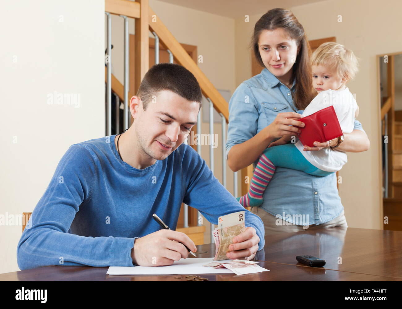 Quarrel in the family of three due to lack of money at home Stock Photo