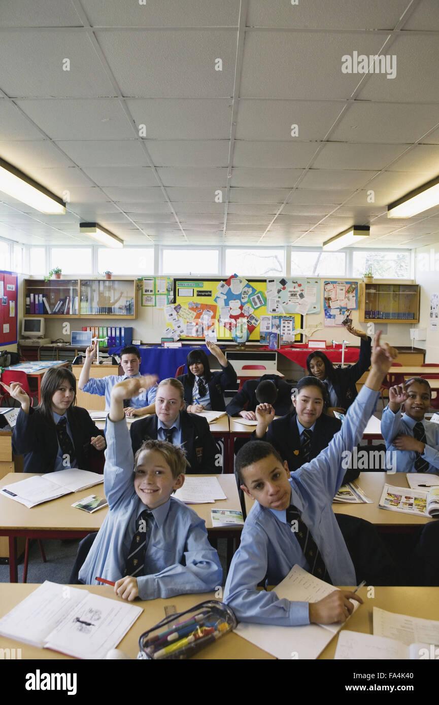 Enthusiastic classroom of  secondary school children, - Stock Image